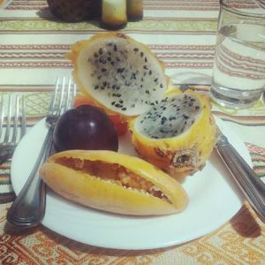 Pitahaya fruit with black seeds, and taxa fruit with an oblong shape