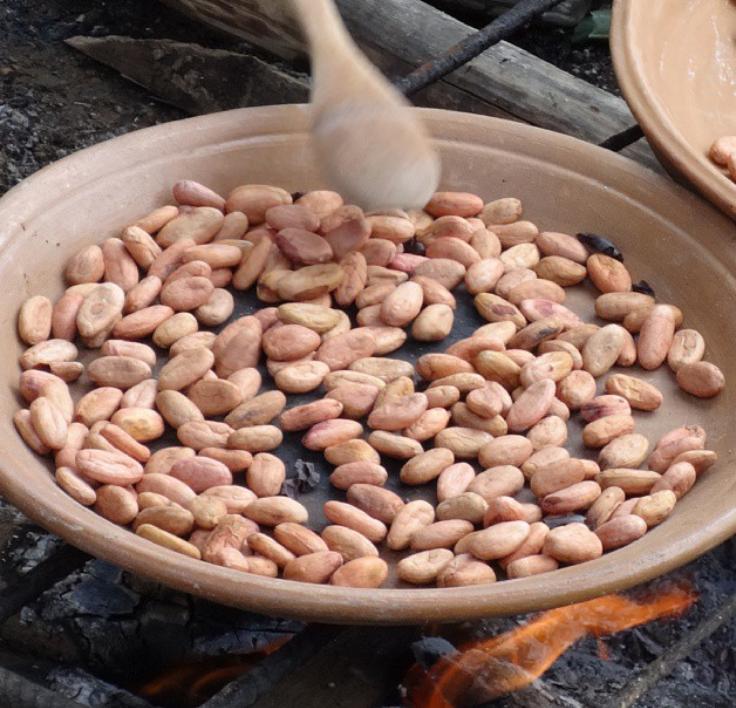 roasting cacao on a farm in ecuador