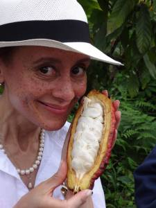 With a freshly opened cocoa pod on a Pacari family farm