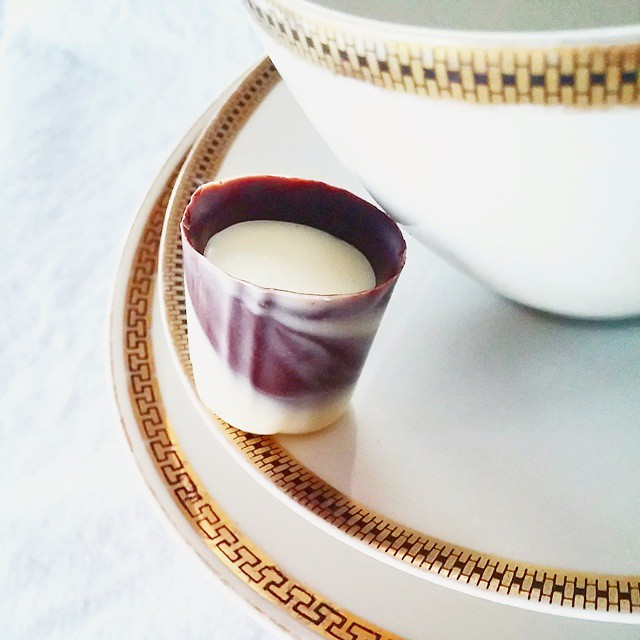 The Vietnamese Ice Coffee: chocolate ganache, with coffee and milk, in a dark chocolate cup.