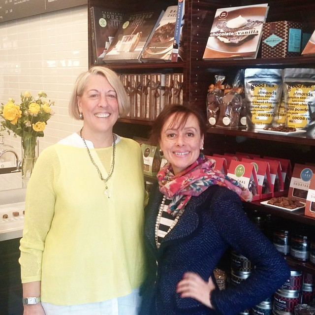 with Cocoa + Co. owner Kim Hack (left) on opening day at her shop