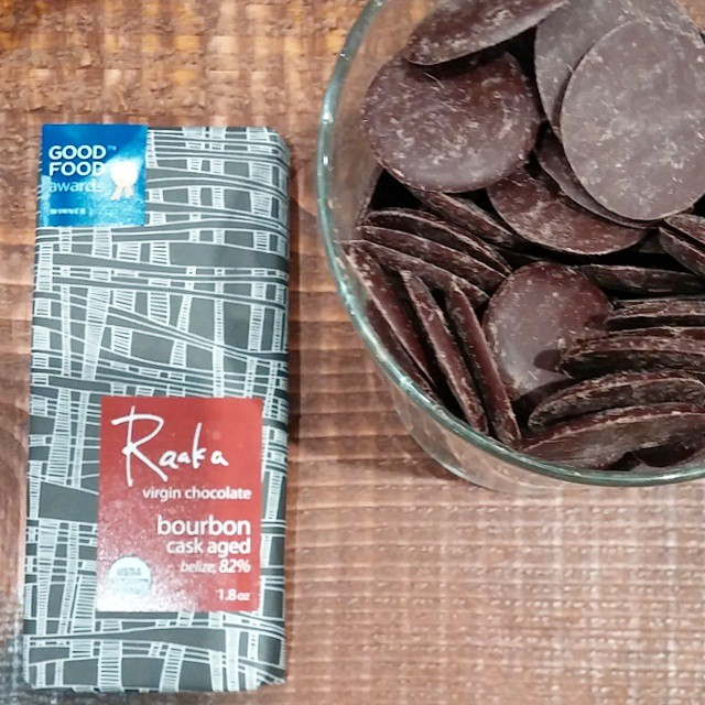 Raw craft chocolate by Raaka, Belize origin, aged in bourbon casks, for a rich and appealing intensity